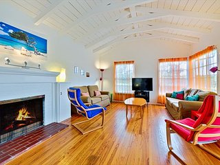 Classic high beam ceilings and fireplace make the living area open and breezy, couch is a sleeper sofa. Beautiful hardwood flooring through out the home.