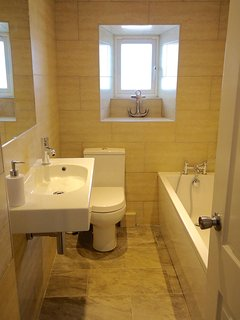 downstairs bathroom with bath (there is also a shower room upstairs)