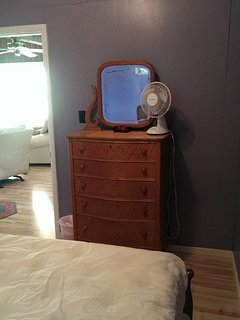Bedroom 1 contains a full size bed and an antique chest of drawers with a standard size closet.