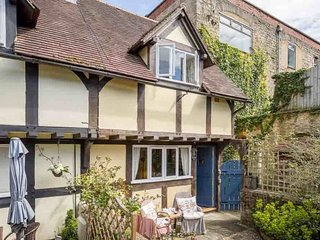 Castle Mews is a hidden gem of a cottage, at the end of a short row of cottages