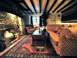 A characterful living room, with a roaring real fire