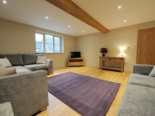 The spacious yet cosy living room, with seating for six