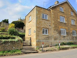 Plum Tree Cottage is at the end of a row of six Cotswold stone cottages