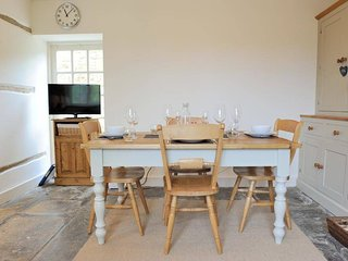 Wooden dining table for four
