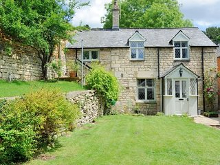 Rose Tree Cottage is a grade II listed, detached Cotswold stone cottage