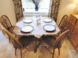 Folding dining table, with seating for up to five