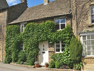 Whitsun Cottage is a beautiful Cotswold stone cottage, clad in Virginia creeper