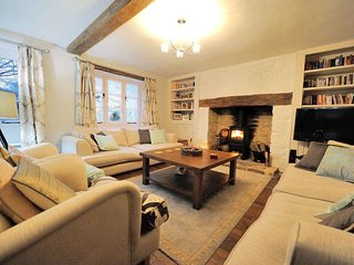 Cosy and inviting living room, with log burner