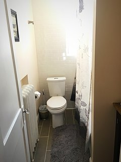 Newly renovated bathroom with tub and shower.