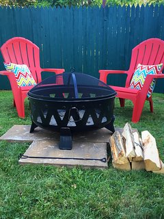 Sip your favorite beverage around a backyard camp fire!  Hey who has the graham crackers?!?