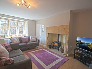 The living space at Hyem is packed with style, enjoy the log burner and 40' LED TV in comfort.