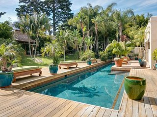 Balinese-Inspired Beauty With Tropical Backyard and Pool.