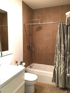 2 bathroom upstairs has identical design; rain showers; bath tubs; ceramic tile