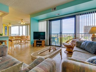 Walk to beach from colorful condo w/gorgeous beach views & shared pool to enjoy!