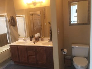 your bath w/ double sinks and garden tub shower, all linens provided