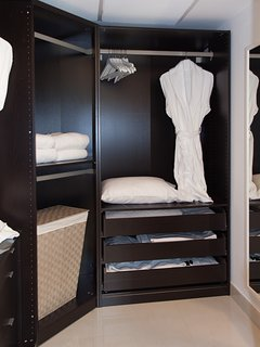 Large walk-in closet ready to welcome you