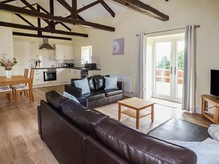 THE STABLES, barn conversion, two double bedrooms, pet-friendly, private patio