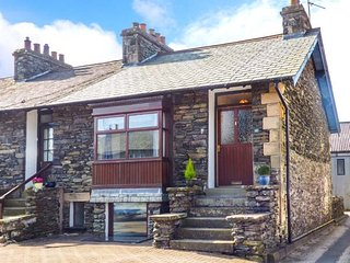 MILL BECK COTTAGE, end-terrace, woodburner, off road parking, enclosed patio