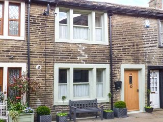 BAY COTTAGE, romantic pet-friendly character cottage, woodburners, WiFi, heart