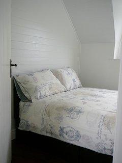 Bedroom 2 (compact room) with Cupboard space opposite bedroom in hallway