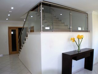 Entrance lobby and staircase to 1st floor.