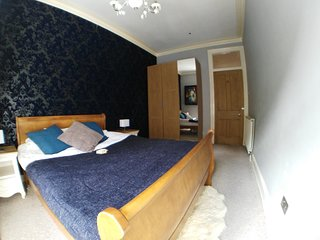 Large main bedroom with plenty of storage