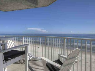Adirondack chairs & table on your private balcony overlooking the Atlantic Ocean, Sunglow Fishing Pier within walking distance