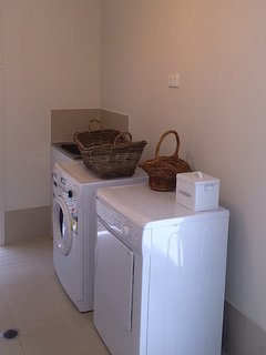Laundry with washer and dryer.