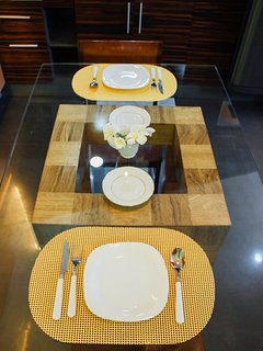 Dining table Complete with 4 sets of plates, bowls, mugs, glasses and spoon and fork.