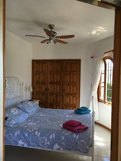Tower bedroom, kingsize bed, ceiling fans, bright and airy opens to large terrace