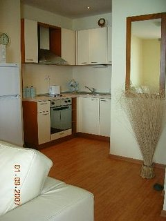 A fully equipped kitchen with all the usual refinements.