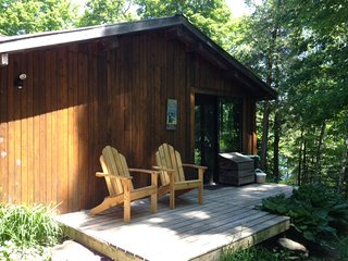 Cottage entrance with comfortable Muskoka Chairs