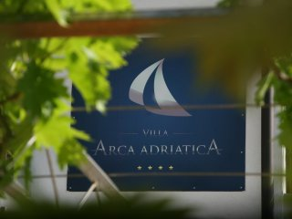 Arca Adriatica Logo on Villa Front