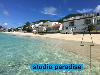 studio paradise feet in water on grand case beach.