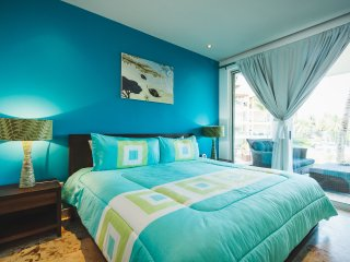 Master suite with king bed, ocean view and TV