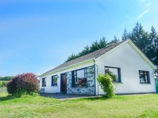 NEWPARK LODGE, detached bungalow with an open fire and a lawned garden, Kilchreest