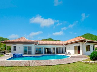 This impressive 5 bedroom, 5 1/2 bathroom luxurious villa is located in Guana