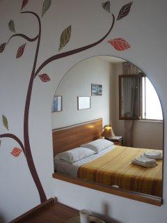 la camera da letto tripla  vista mare