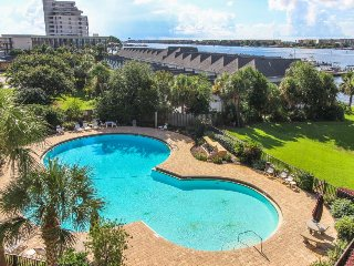 Beautiful bayfront condo with pool access, beach, and a nearby dock!