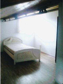 One of the bedrooms of right hand side top apartment