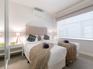 Splittable queen bed with air con, large mirrored robes, double glazing, bedside tables & lamps