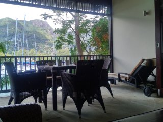 Spacious breezy Veranda with alfresco dining set  and Sunlounger