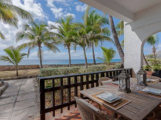 Ground floor oceanfront apartment at Porto Cupecoy