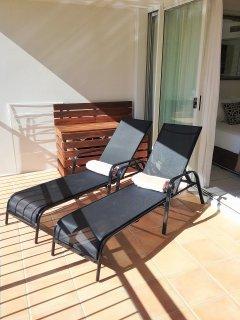 Sun lounges on unit balcony