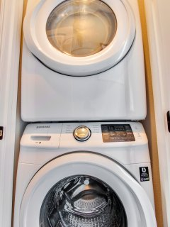 Full size front loader washer / dryer. Laundry soap provided.