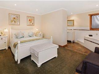 Bedroom 1 - Qs bed with open plan ensuitebathroom