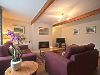 The Living Room is spacious with character, 32' LDC TV, Wii games console, books and DVDs