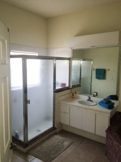 Master Bed En-Suite oversized shower cubicle separate bath tub twin vanity units with mirrors