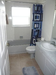 Second bathroom with full size vanity unit shaving point shower and bath tub