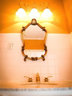 East Room Private Bathroom has marble vanity and combination shower/bathtub.